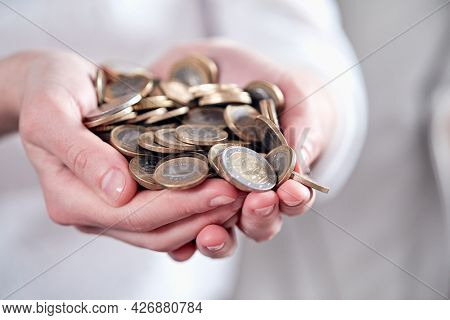 euro coins in the hand
