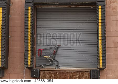 Shopping Cart Abandoned At A Unloading Dock Bay Door