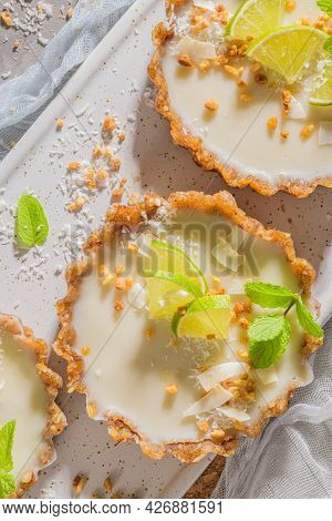 Lime Vegan Tarts With Grated Coconut  And Crunchy Peanuts. Citrus Cake. Date, Walnut, Almond And Haz
