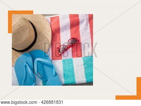 Photograph of flip flops, sunglasses and starfish against grey background. summer holiday and vacation concept