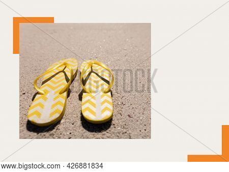 Photograph of yellow flip flops at the beach against grey background. summer holiday and vacation concept