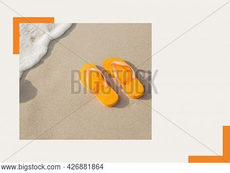 Photograph of orange flip flops at the beach against grey background. summer holiday and vacation concept