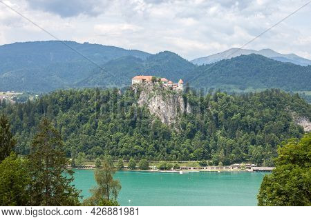 Panorama Of The Bled Lake, Blejsko Jezero, With Its Castle, Blejski Hrad, During A Cloudy Summer Wit