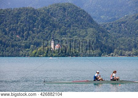 Bled, Slovenia - June 13, 2021: Two Young Female Adults, Rowers, On A Coxless Pair Four, A Rowing Bo