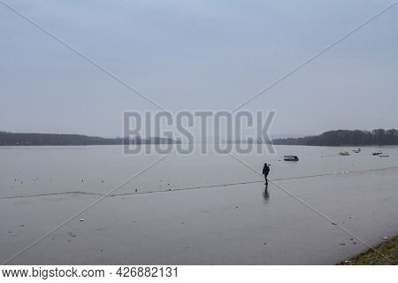 Belgrade, Serbia - January 31, 2016: Man Walking Alone Near The Danube River During A Heavily Foggy