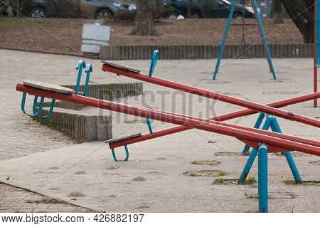 Selective Blur And Close Up On An Empty Children See Saw, Or Teeter Totter In A Playground, With Nob