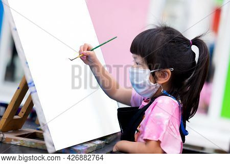 Schoolgirl Are Working On Watercolor Paintings On Canvas. Student Wearing White Cloth Mask While Stu