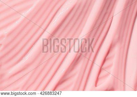 .creamy Pink Skincare Lotion Mousse Product Closeup. Peach Cream, Moisturizer, Shampoo Spread, Sunsc