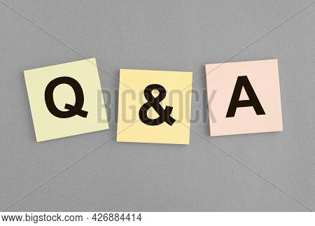 Qna Inscription On Notes. Qa Acronym. Q Concept. Questions And Answers Abbreviation On Grey Backgrou