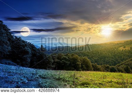 Time Change Above Countryside Landscape. Carpathian Mountains Beneath A Sky With Sun And Moon Above