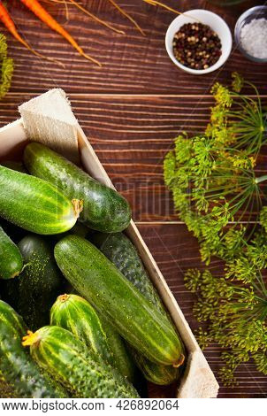 Pickled Marinated Cucumbers In A Kitchen Table With Dill, And Garlic