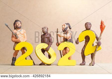 Miniature Primitive People Celebrating New Year 2022