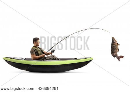 Man catching a carp fish from a canoe isolated on white background