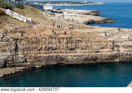 Polignano A Mare, Italy - September 17, 2019: Rocky Shore In Polignano A Mare. Apulia, Italy