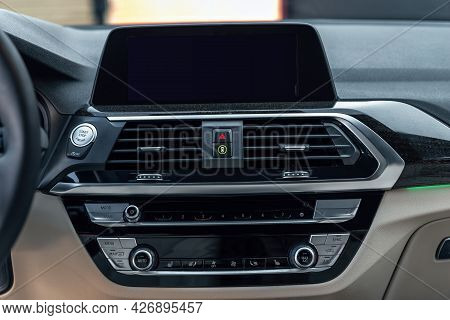 Premium Car Interior With Multimedia Display And Dashboard. Control Panel, Radio System, Air Conditi