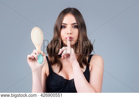 Woman Is Making Hairstyle With Comb. Beautiful Young Woman Holding Healthy And Shiny Hair, Studio. C