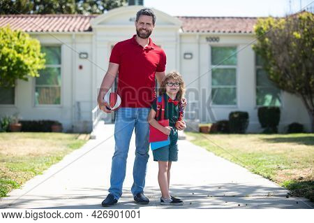 Father Supports And Motivates Son. Child Education. Kid Going To Primary School.