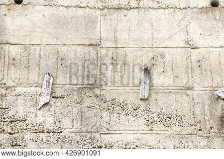 Concrete Wall Surface With Holes And Traces Of Formwork, Background
