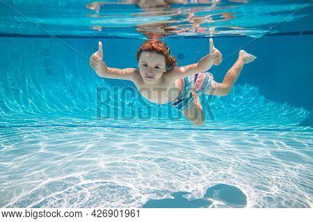 Underwater Kid Swim Under Water. Child Boy Swimming And Diving Underwater In Pool. Summer Family Sum