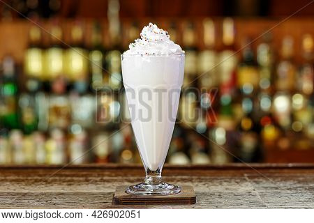 Milkshake In The Cafe Is On A Blurry Bar Counter Background