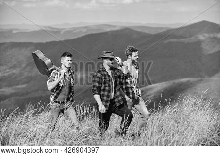Men With Guitar Hiking On Sunny Day. Hiking With Friends. Long Route. Adventurers Squad. Tourists Hi