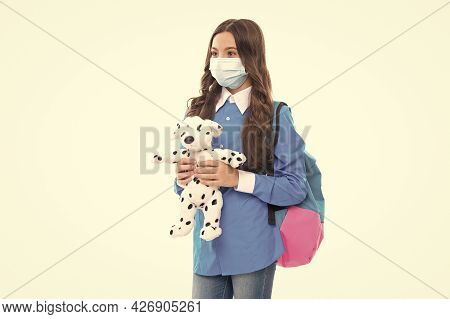 Infection Control In School And Childcare. Kid In Mask Hold Toy. Novel Coronavirus Infection