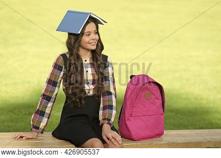 Fun Filled Learning. Funny Child Hold Book On Head. School Library. Reading Education. Knowledge And