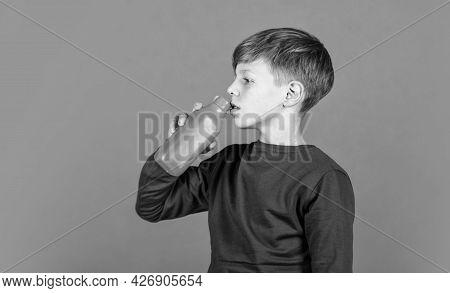 Refreshing Beverage Concept. Water Balance. Small Child Drink Juice Orange Background. Little Boy En