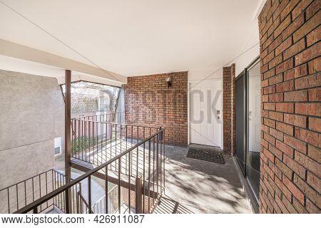 Front Door Of A Second Floor Apartment With Veranda