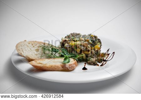 Vegetable Caviar Or Stew With Eggplant, Zucchini And Bell Pepper On White Plate