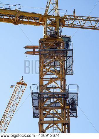 The Upper Part Of A Metal Structure Of A Tower Crane With Platforms, A Cabin And A Part Of The Boom