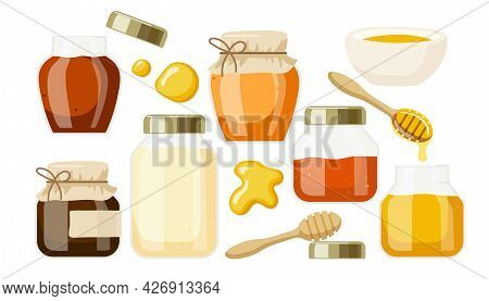 Bee Honey Of Different Varieties In Glass Jars And Bowl, Wooden Honey Spoon, Honey Drops Isolated On