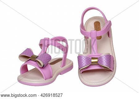 Pink Sandals Isolated. Close-up Of Cute Pink Sandals With A Bow For The Little Girl Isolated On A Wh