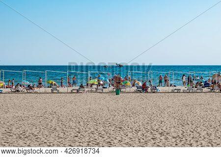 Zaliznyi Port, Ukraine - July 23, 2020: Beach Coastline In The Resort Village Of Zalizny Port. Peopl