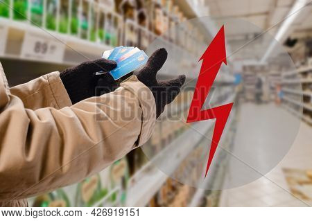 Man Doing Purchases In Grocery Shop With Credit Card. The Arrow Shows The Rise In Value