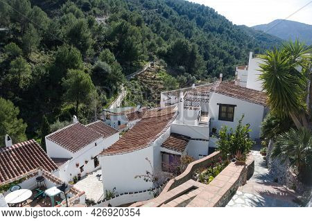 Frigiliana, Spain. Tiled Rooftops In The Small Hamlet Of Of El Acebuchal. High Angle View With Backb