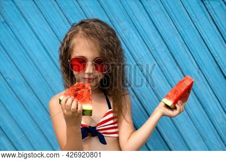 A Beautiful Girl Savors A Piece Of Ripe Juicy Sweet Watermelon With Pleasure. Curly Stylish Girl In