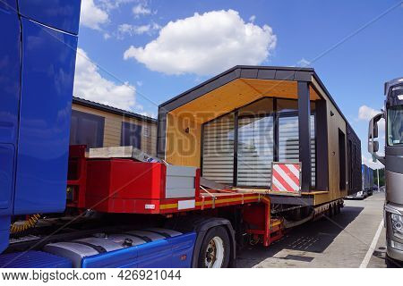 Oversized Cargo Or Exceptional Convoy (convoi Exceptionnel). A Truck With A Special Semi-trailer For