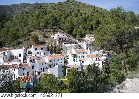 Pretty Spanish Village Of El Acebuchal. High Angle View Of The Small Hamlet With Traditional Whitewa
