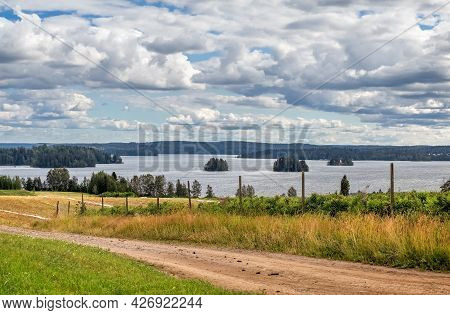 Agricultural Fields Near The Lake. Lake With Islands. Photo