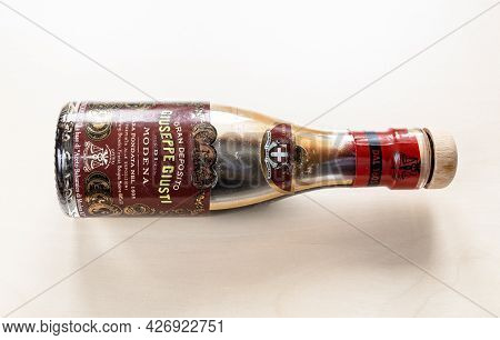 Moscow, Russia - June 10, 2021: Lying Used Glass Bottle Of Aged Giuseppe Giusti Aceto Balsamico Di M
