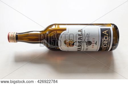 Moscow, Russia - June 10, 2021: Lying Open Bottle Of Sweet Marsala From Cantine Intorcia. Marsala Is