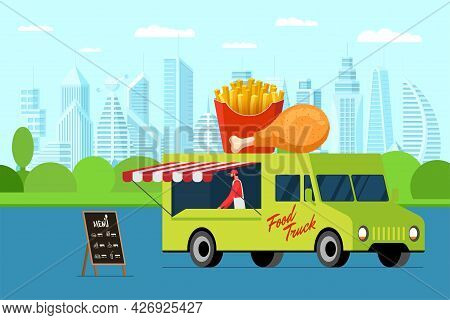 Fast Food Street Truck With Menu Signboard Outdoor City Park. Chicken And French Fries On Van Roof.