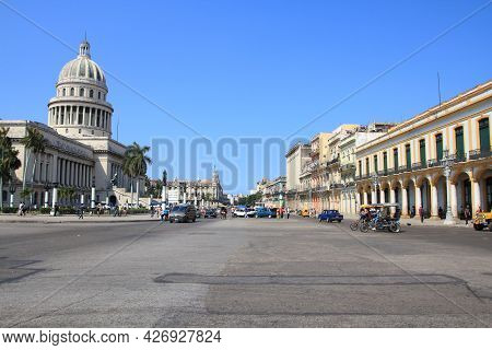 Havana, Cuba - February 26, 2011: People Visit Paseo De Marti Street In Havana, Cuba. The Building O