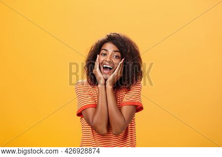 Dreamy Good-looking Stylish Young African Female With Curly Hairstyle Sighing Leaning Head On Palms