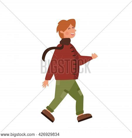 Little Funny Chubby Boy On An Autumn Walk. Happy Red-haired Schoolboy Goes. Kid In A Warm Red Coat A