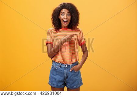 Hey Awesme Copy Space There. Portrait Of Impressed And Surprised Enthusiastic Young African American