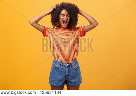 I Hate Life Being Cruel. Depressed African Woman In Rage And Fury Pulling Hair Out Of Head Yelling A