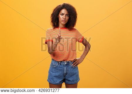 You Better Not. Dissatisfied Bossy Serious-looking African American Curly-haired Female Head Manager
