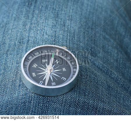 Classic Compass On Denim Background As Symbol Of Tourism With Compass, Travel With Compass And Outdo